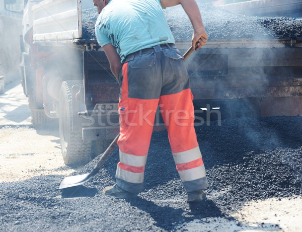 Stock photo: Hard work on asphalt construction