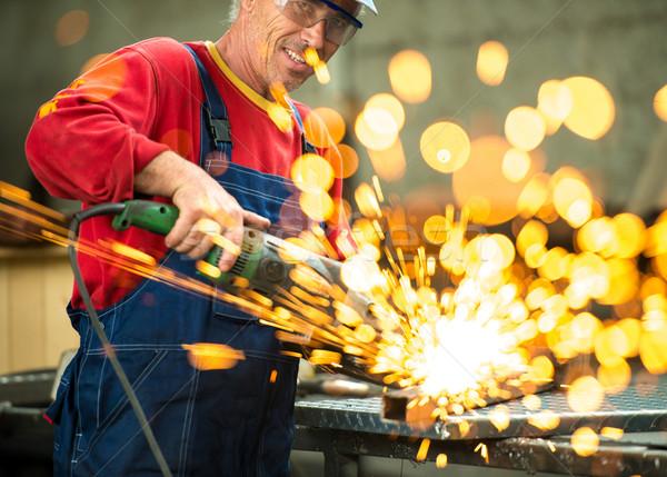 Senior worker cutting metal Stock photo © zurijeta
