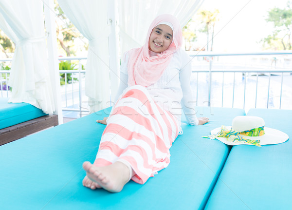 Happy Muslim family on summer vacation on bed Stock photo © zurijeta