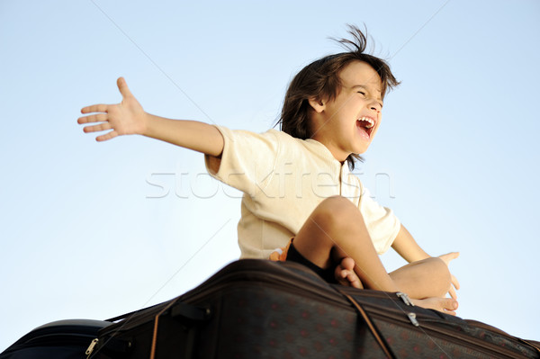 Little boy traveling on bags, the top of the car Stock photo © zurijeta