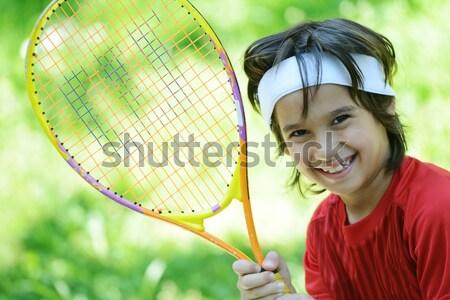 Kid playing tennis Stock photo © zurijeta