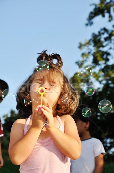 Meisje zeepbellen meisje gezicht licht Stockfoto © zurijeta
