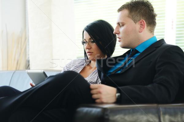 молодые бизнесмен деловой женщины сидят служба лобби Сток-фото © zurijeta