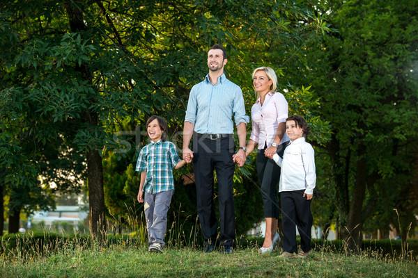 Boldog család park boldog mosolyog család áll Stock fotó © zurijeta