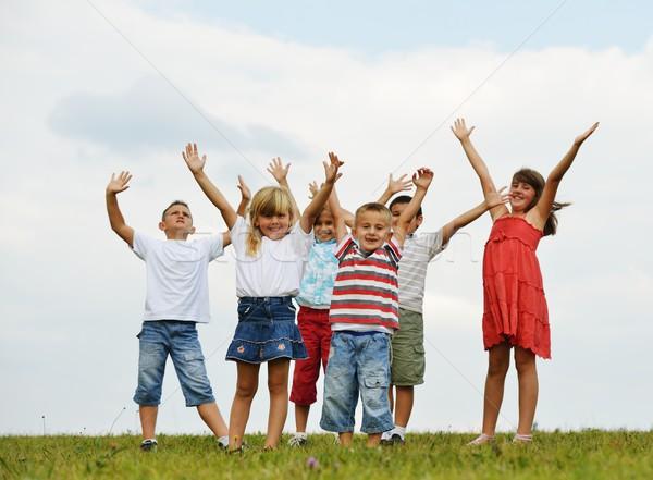 Happy children on summer grass meadow in nature Stock photo © zurijeta