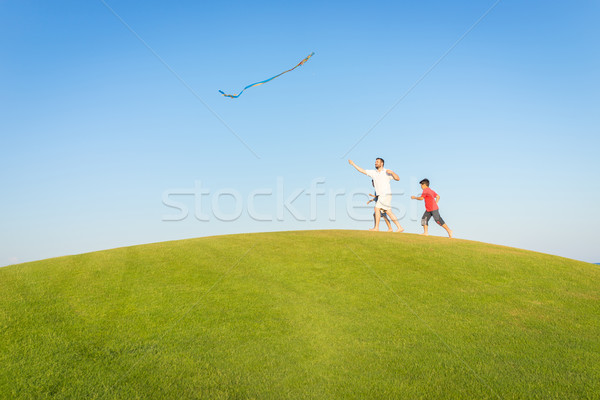 Running with kite on summer holiday vacation, perfect meadow and Stock photo © zurijeta