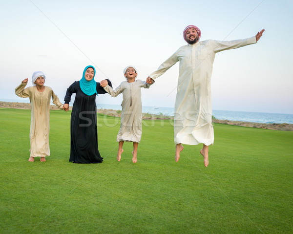 Arabic family on green meadow in nature Stock photo © zurijeta