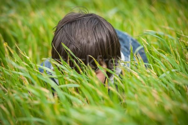 Feliz criança belo verde amarelo campo de grama Foto stock © zurijeta