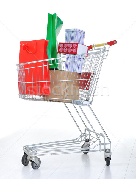 Shopping cart with boxes and bags in Stock photo © zurijeta