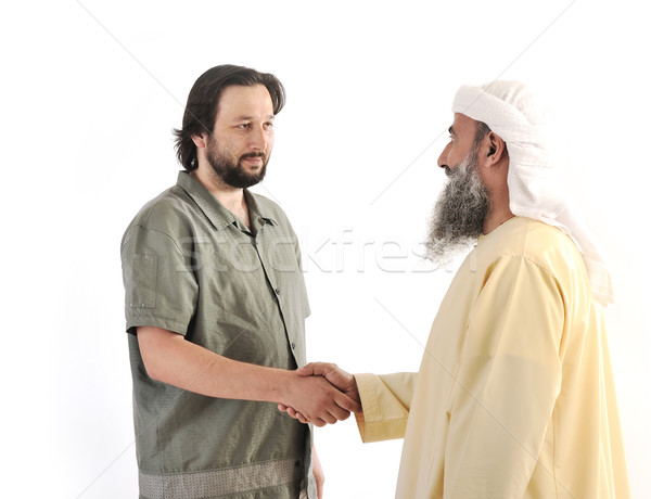 Arabic Muslim businessman person shaking hands on meeting Stock photo © zurijeta