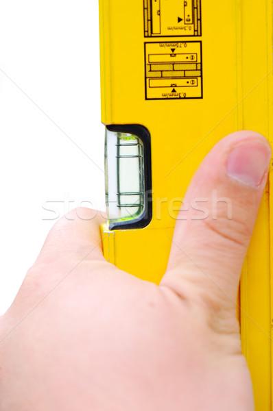 Mano giallo livello strumento acqua Foto d'archivio © zurijeta