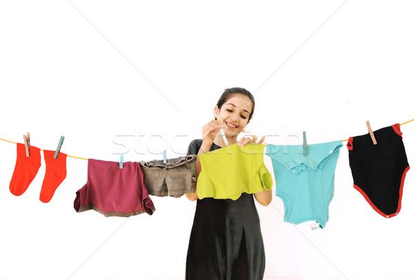 Beautiful little girl doing laundry Stock photo © zurijeta