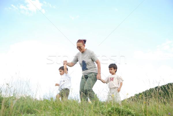 Boldog kettő gyerekek természet nagymama égbolt Stock fotó © zurijeta