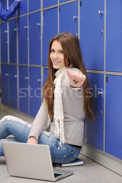 Beautiful female blond student inside the university Stock photo © zurijeta