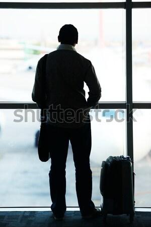 Staff member riding special vehicle on airport Stock photo © zurijeta