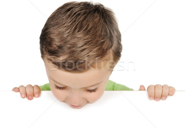 Young boy looking down over white blank sign Stock photo © zurijeta