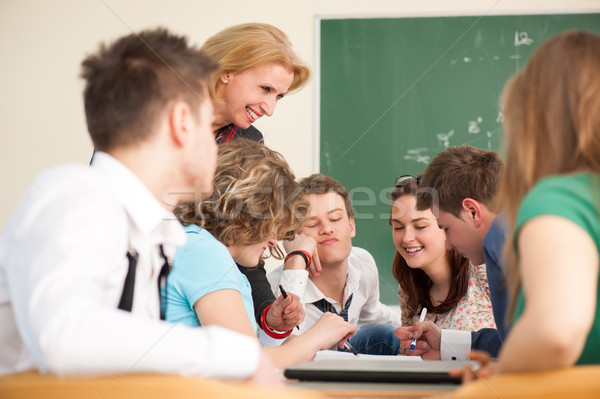 Stock photo: Cheerful professor with students