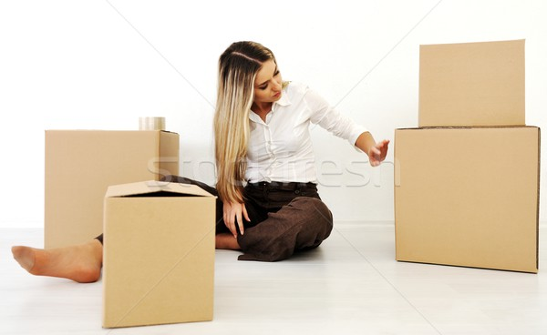 A young teen woman with her luggage and belongings moving home Stock photo © zurijeta