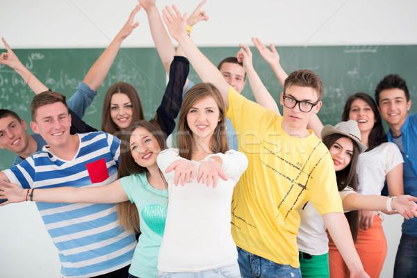 Derűs osztálytársak pózol osztályterem zöld tábla Stock fotó © zurijeta