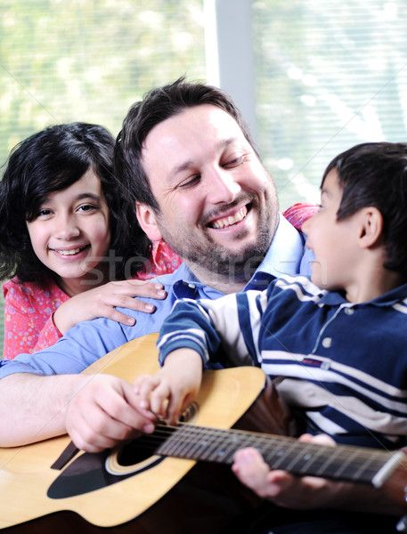 Happy family playing guitar together Stock photo © zurijeta