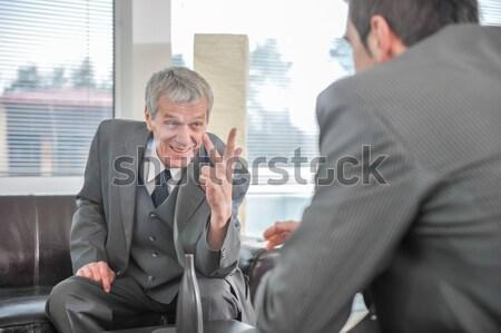 Uomini d'affari parlando boss dito punta ufficio Foto d'archivio © zurijeta