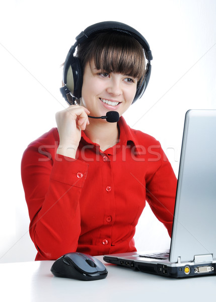 Beautiful Customer Representative with headset smiling during a telephone conversation Stock photo © zurijeta