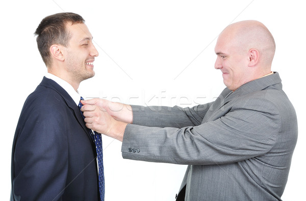 One businessman teaching another one how to tie his tie Stock photo © zurijeta