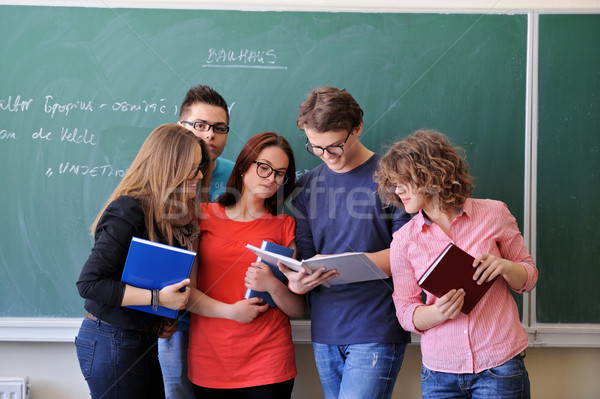 Students reading in classroom Stock photo © zurijeta