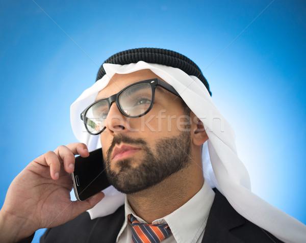 Portrait of attractive Arab man with phone Stock photo © zurijeta