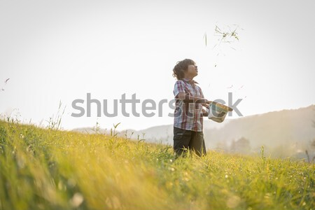 Boy standing in nature with birds in background Stock photo © zurijeta