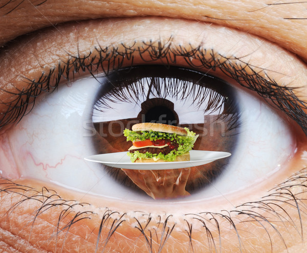 Closeup of hungry human eye macro mode with double exposure and  Stock photo © zurijeta