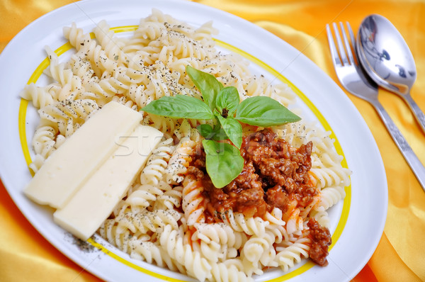 Italian macaroni with original ingredients, on golden fabric  Stock photo © zurijeta