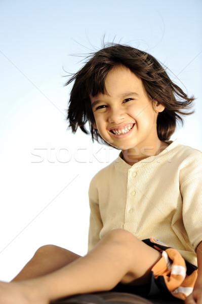 Happy summer boy sitting, wind in hair Stock photo © zurijeta