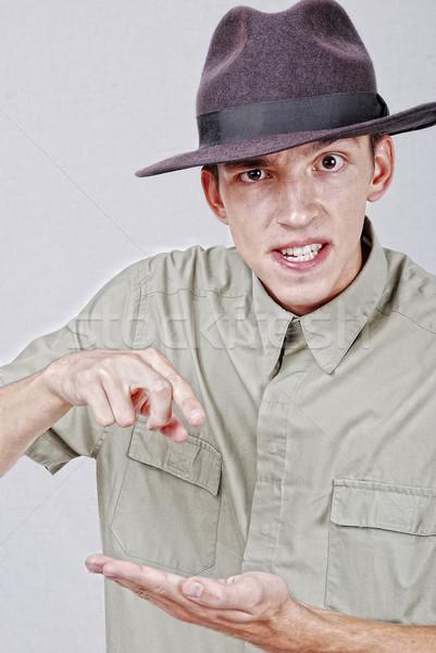 молодые Hat указывая пальца счастливым моде Сток-фото © zurijeta