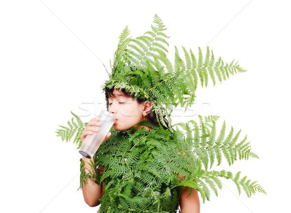 Pretty little girl dressed in green plant leafs Stock photo © zurijeta