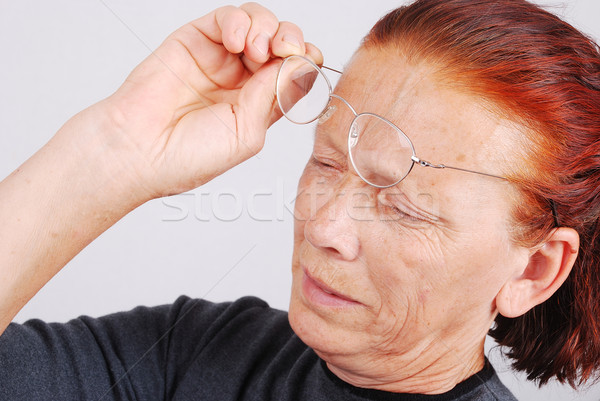 Elderly woman has a problem with sight, glasses don't help Stock photo © zurijeta