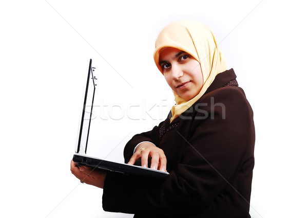 Young muslim female in traditional clothes with laptop Stock photo © zurijeta