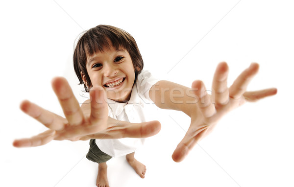 Positive cute kid trying to catch you Stock photo © zurijeta