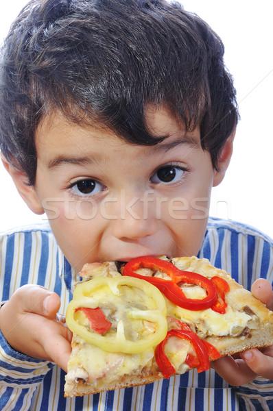 Kid eten pizza voedsel glimlach gelukkig Stockfoto © zurijeta