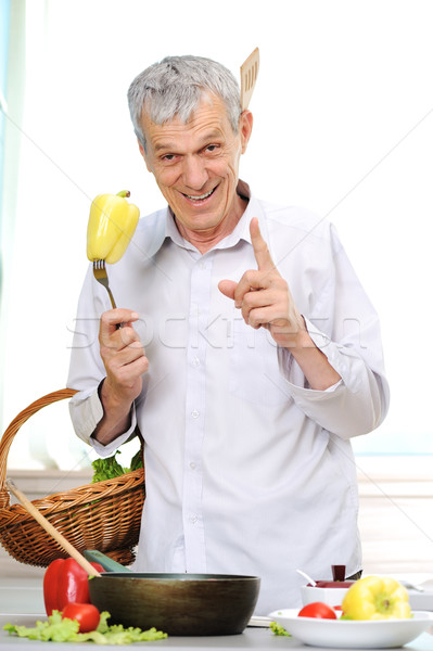 Good looking elderly man working in kitchen Stock photo © zurijeta