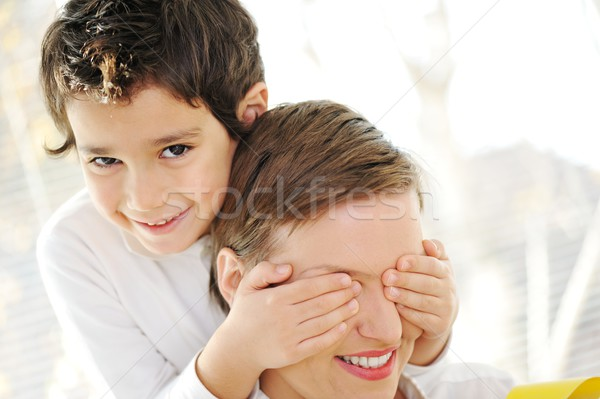 Family portrait of mother and son at home Stock photo © zurijeta
