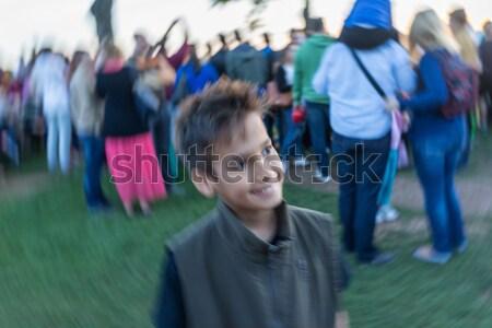 Beautiful kid in front of friends in gym hall Stock photo © zurijeta