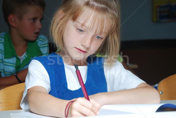 Little cute girl in classroom, writting Stock photo © zurijeta