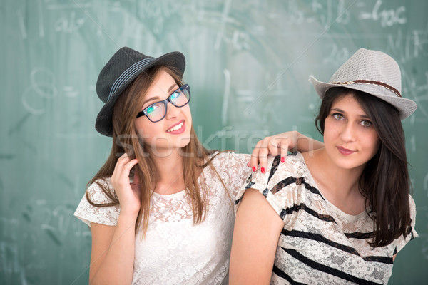 Two female students with hats Stock photo © zurijeta