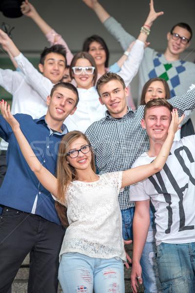 Mosolyog derűs pózol iskola lépcsősor csoport Stock fotó © zurijeta