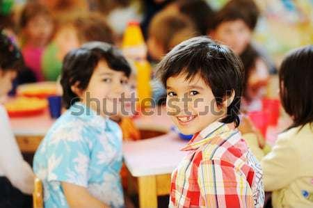 Kids celebrating birthday party in kindergarden playground Stock photo © zurijeta