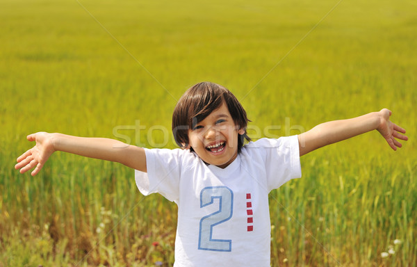 Happy boy with open arms outdoor Stock photo © zurijeta