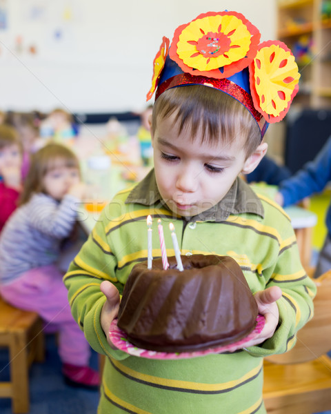 Little cute boy having birthday party at kindergarden Stock photo © zurijeta