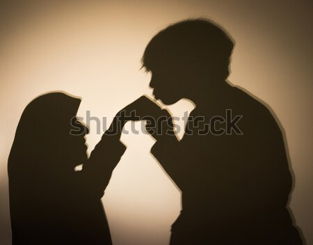 Stock photo: Silhouette of Muslim woman with her son