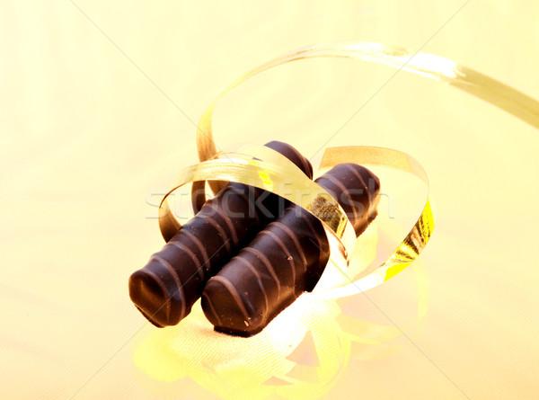 Chocolate on golden banner Stock photo © zurijeta